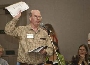 GPUS Political Director Brent McMillan waves his political/ fundraising report while speaking at the annual meeting.
