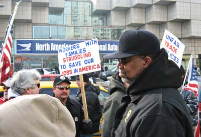 Union autoworkers and supporters protest declining conditions this January at the Detroit Auto Show.