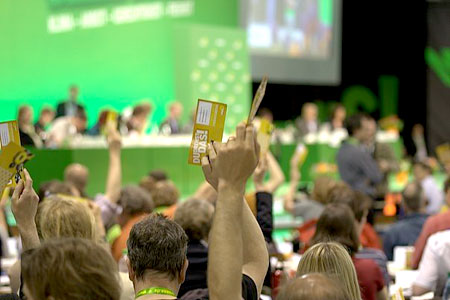 German Greens hold up their vote at the Congress gathering in Berlin. photo by Tobi Specht