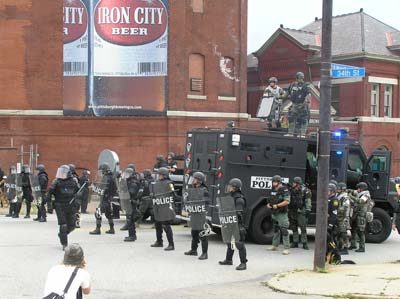 Police block participants at the G20 Summit march on September 24th in Pittsburgh Pennsylvania. They are standing in front of Iron City Brewery, which has moved out of the city. Photo by Mark Child